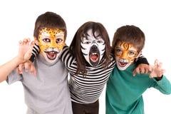 Crianças com cara-pintura Fotos de Stock Royalty Free