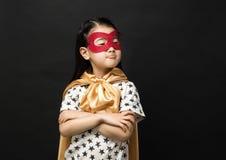 Crianças do super-herói em um fundo preto Fotos de Stock Royalty Free
