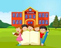 Crianças dos desenhos animados com livro e lápis Fotografia de Stock Royalty Free