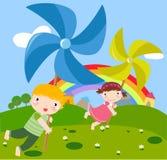 Crianças e pinwheel Fotos de Stock