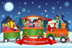 Crianças e Santa Claus em presentes de Natal levando do trem Imagens de Stock