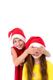 Crianças em tampões do Natal Fotografia de Stock Royalty Free