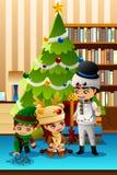 Crianças que comemoram o Natal na frente da árvore de Natal Foto de Stock