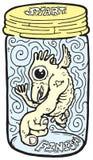 Criatura en un tarro imagen de archivo