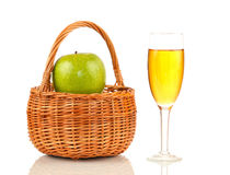 Crib with apples and glass of juice on white background Royalty Free Stock Photo
