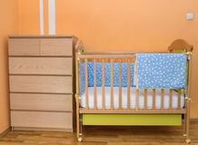 Crib. Baby bed in bedroom Stock Photo