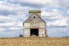 Crib Barn and Cloudy Sky Stock Photography