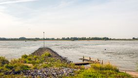 Crib built from basalt stones in a wide Dutch river Royalty Free Stock Images