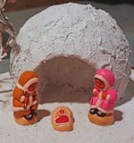 Crib with the Eskimos to the north pole and a white ice igloo Royalty Free Stock Image