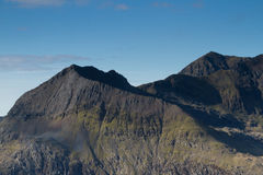 Crib Goch. The east face and north ridge of Crib Goch with mount Snowdon in the distance, located in the Snowdonia National Park, Wales, UK Stock Photography