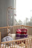 Crib for an infant decorated with toys Stock Photo
