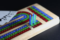 Cribbage board. Partly shadowed ready to play game Royalty Free Stock Images