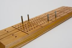 Cribbage board. A wooden cribbage board in use Royalty Free Stock Images