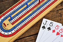 Cribbage board and playing cards Stock Image