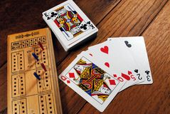 Cribbage Game. A cribbage board with cards Stock Photos