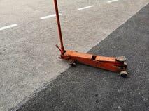 Cric hydraulic used car lift. Day stock photos