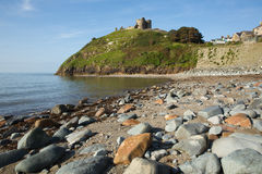 Criccieth rocky beach Wales UK historic coastal town in summer with blue sky on a beautiful day Royalty Free Stock Photos