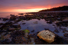 Criccieth traeth. Treath means beach in Welsh, is on the coast near Pwhelli. This image was taken at sunset Stock Photos