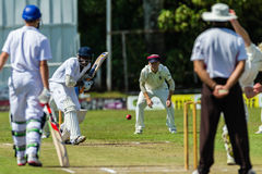 Cricket Action Sport. Batman plays ball, cricket game action with batsmen and bowlers between Westville plays Durban Boys High 1st Teams school derby stock photos
