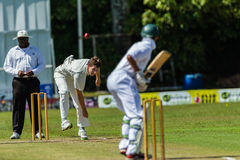 Cricket Action Sport. Batman plays ball,cricket game action with batsmen and bowlers  between Westville plays Durban Boys High 1st Teams school derby Stock Images
