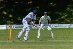 Cricket Action Sport. Batman plays ball,cricket game action with batsmen and bowlers  between Westville plays Durban Boys High 1st Teams school derby Royalty Free Stock Images