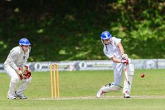 Cricket Action Sport. Batman plays ball,cricket game action with batsmen and bowlers between Westville plays Durban Boys High 1st Teams school derby stock photo