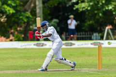 Cricket Action Sport. Batman strikes ball,cricket game action with batsmen and bowlers  between Westville plays Durban Boys High 1st Teams school derby Royalty Free Stock Image