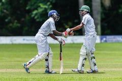 Cricket Action Sport. Batsmen congratulate efforts,cricket game action with batsmen and bowlers  between Westville plays Durban Boys High 1st Teams school derby Royalty Free Stock Photos
