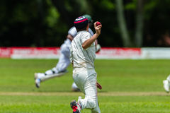 Cricket Action Sport. Fielder player throws all,cricket game action with batsmen and bowlers between Westville plays Durban Boys High 1st Teams school derby stock photo
