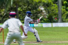 Cricket Action Sport. Batman strikes ball,cricket game action with batsmen and bowlers  between Westville plays Durban Boys High 1st Teams school derby Royalty Free Stock Photo