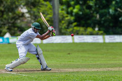 Cricket Action Sport. Batman strikes ball,cricket game action with batsmen and bowlers between Westville plays Durban Boys High 1st Teams school derby royalty free stock photography