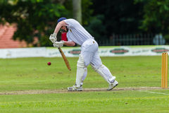 Cricket Action Sport. Batman strikes ball,cricket game action with batsmen and bowlers between Westville plays Durban Boys High 1st Teams school derby royalty free stock images