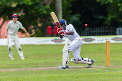 Cricket Action Sport. Batman strikes ball,cricket game action with batsmen and bowlers between Westville plays Durban Boys High 1st Teams school derby stock photo