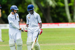 Cricket Action Sport. Batsmen congratulate efforts,cricket game action with batsmen and bowlers  between Westville plays Durban Boys High 1st Teams school derby Stock Image