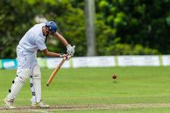 Cricket Action Sport. Batman strikes ball,cricket game action with batsmen and bowlers  between Westville plays Durban Boys High 1st Teams school derby Stock Photos