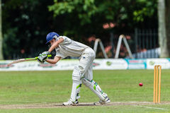 Cricket Action Sport. Batman strikes ball,cricket game action with batsmen and bowlers between Westville plays Durban Boys High 1st Teams school derby stock images