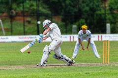 Cricket Action Sport. Batman strikes ball,cricket game action with batsmen and bowlers between Westville plays Durban Boys High 1st Teams school derby stock photography