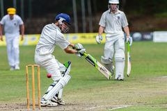 Cricket Action Sport. Batman strikes ball,cricket game action with batsmen and bowlers  between Westville plays Durban Boys High 1st Teams school derby Royalty Free Stock Photos