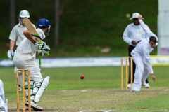 Cricket Action Sport. Bowler bowling fast ball,cricket game action with batsmen and bowlers between Westville plays Durban Boys High 1st Teams school derby royalty free stock photography