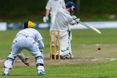 Cricket Action Sport. Wicketkeeper watches batsman and  ball,cricket game action with batsmen and bowlers  between Westville plays Durban Boys High 1st Teams Stock Image