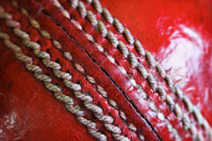 Cricket ball. Close up of old well worn leather cricket ball seam and stitching Royalty Free Stock Image
