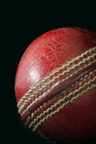 Cricket Ball. Isolated leather Cricket ball on a black background royalty free stock photos