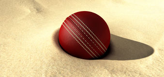 Cricket Ball Buried In Sand Stock Photos