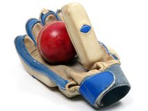 Cricket ball in glove Stock Photos