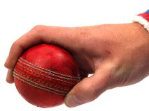 Cricket ball held by hand. Cricket ball held in a spinners grip royalty free stock images