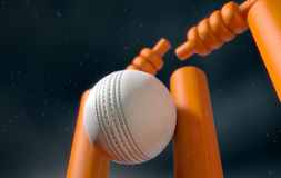 Cricket Ball Hitting Wickets. A close up of a white leather stitched cricket ball hitting orange wickets with dirt particles emanating from the impact at night vector illustration