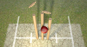 Cricket Ball Hitting Wickets Stock Image