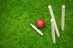 Cricket ball on pitch after hitting stumps Royalty Free Stock Photos