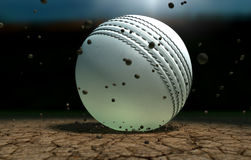 Cricket Ball Striking Ground With Particles At Night Stock Image