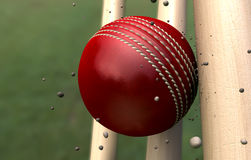 Cricket Ball Striking Wickets With Particles Stock Image